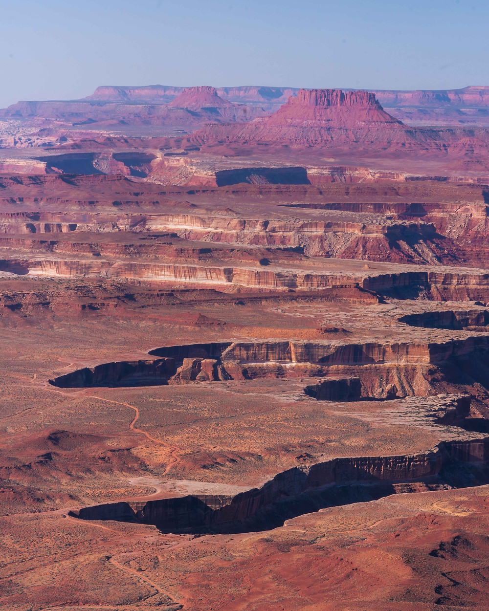 Deep canyons along with red rock mountains along the Green River