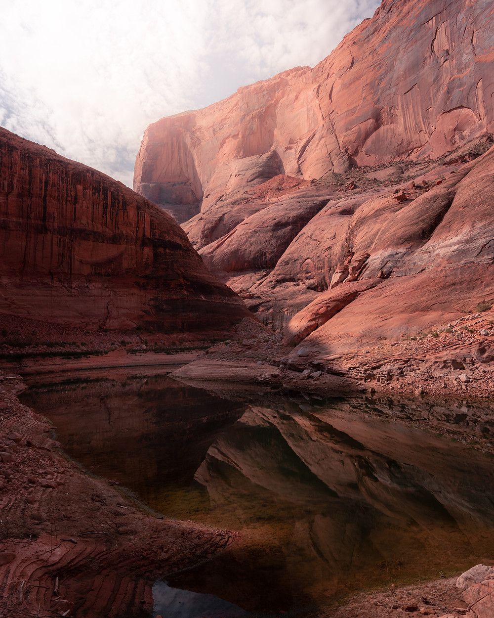 reflections of stone canyons in the lake