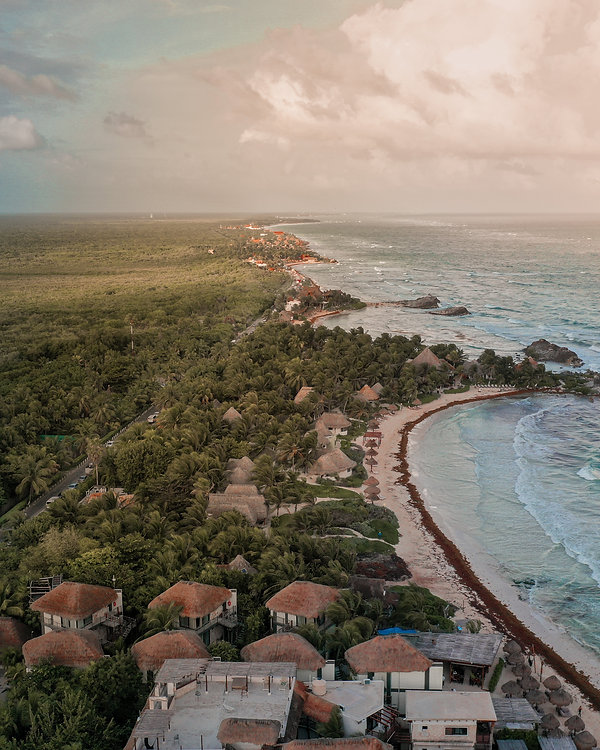 Aerial view of the Tulum Hotel Strip sandwiched between jungle and the caribbean blue ocean