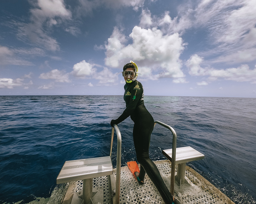 Snorkler in a rash guard about to jump in to the Great Barrier Reef