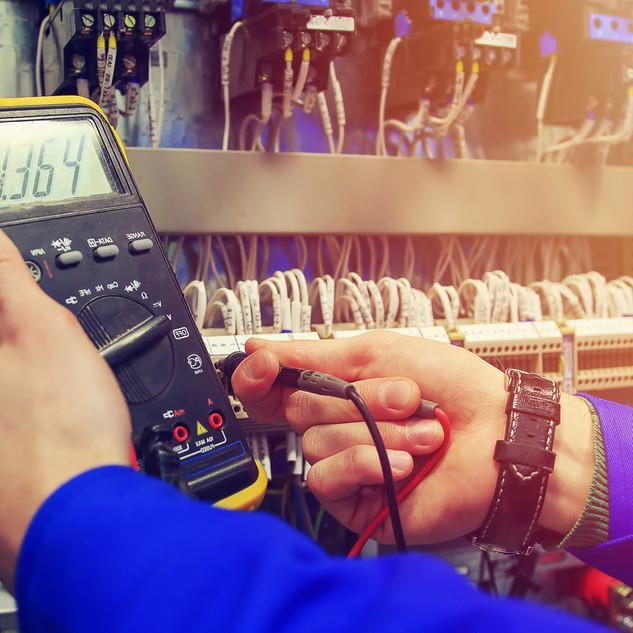 Multimeter in hands of electrician close