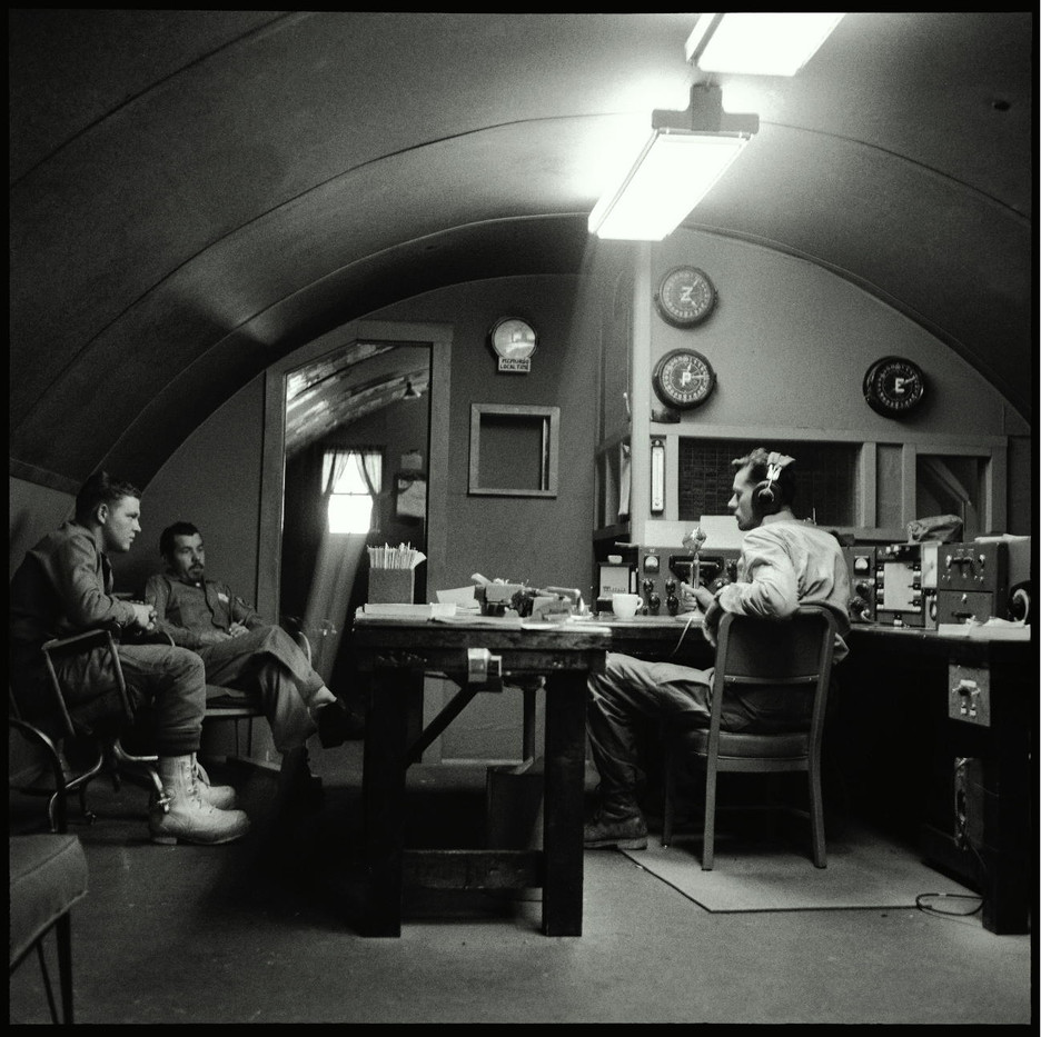 The radio room at McMurdo, housed in a Quonset hut.