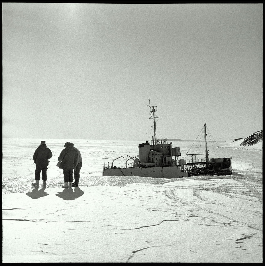 A Navy vessel locked in the ice is utilized for fuel storage.