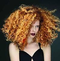 Red hair curly hair model