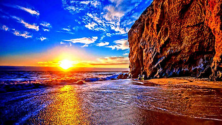 sunset-over-the-sea-and-beach.jpg