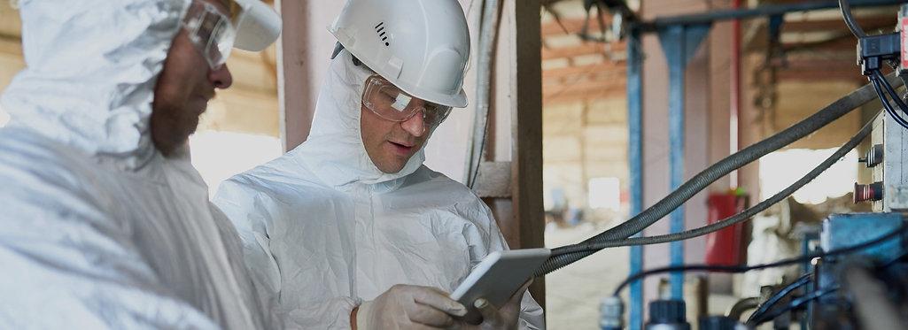 workers-on-biohazard-factory-47SHU39_edi