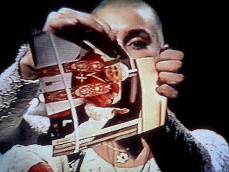 "Sinéad O'Connor tears up a photo of Pope John Paul II on ""Saturday Night Live"" (1992)"