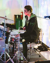 Rein Vaska drumming at Metro's first show in Cubberly Community Center!