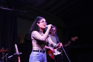 Marina Buendia singing at the Catalyst Gig