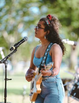 Marina Buendia singing and playing guitar at Bouyancy Music Festival, 2019.