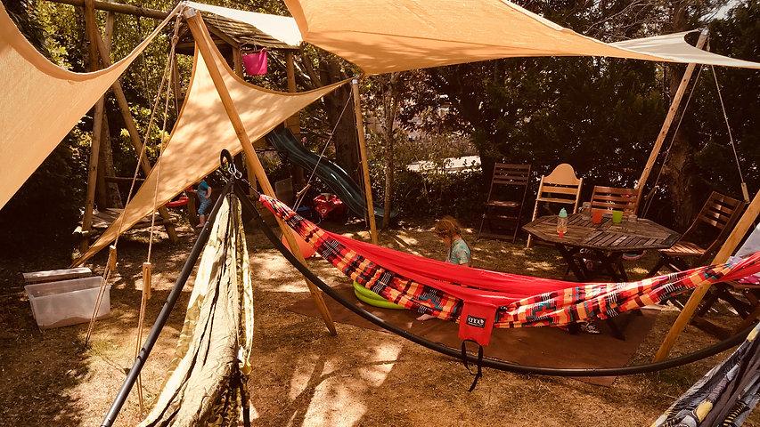 Shady Spot and triple hammock in garden setting