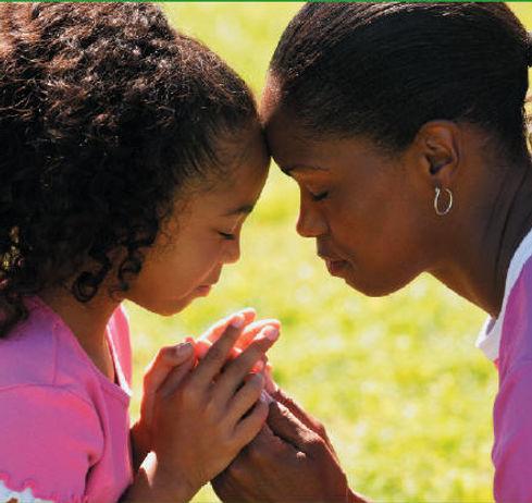 mother and daughter praying.jpg
