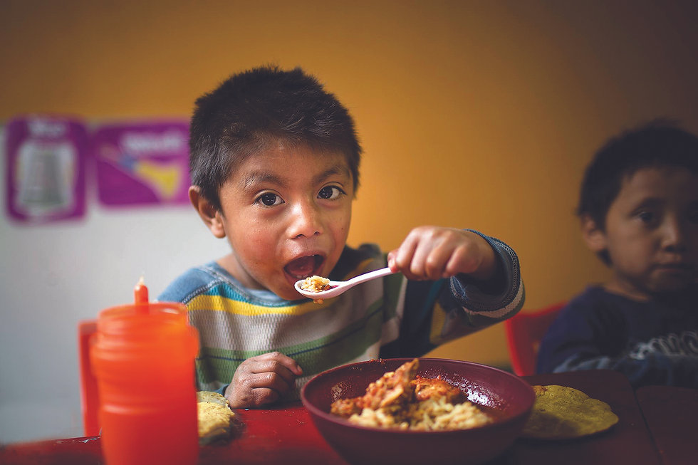 Boy eating NP in Guatemala.jpg