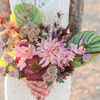 Asymmetrical Pink shades hand tied succulents and flowers