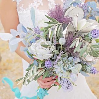 large hand tied long stem bouquet purples blues silvers