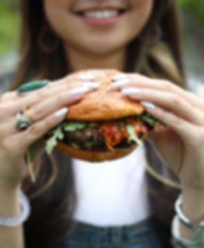 Young woman enjying lamb burger