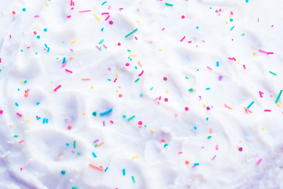 Confectionery Topping. Colored topping for cakes. Sprinkled cream cake.jpg