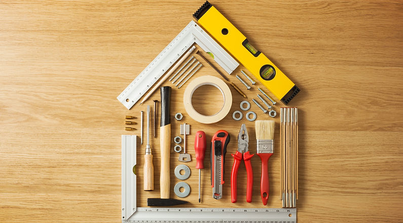 Conceptual%20house%20composed%20of%20DIY%20and%20construction%20tools%20on%20hardwood%20flooring%2C%