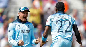 england cricket team players jason roy and jofra archer in blue englanc cricket team jersey in a match against pakistan cricket team in the icc cricket world cup 2019.