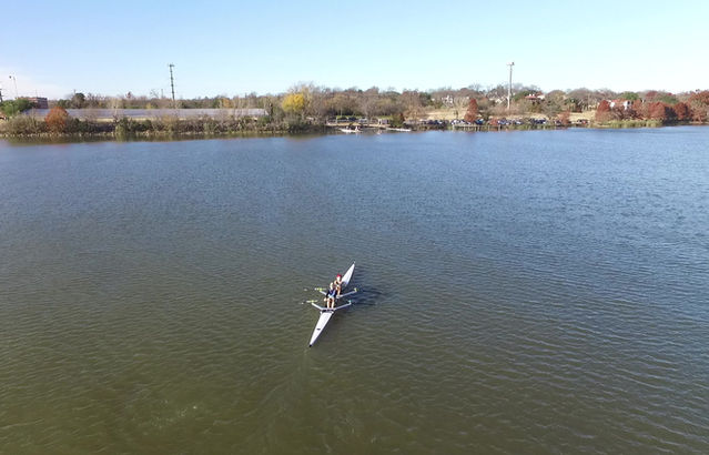 A sky view of the boathouse and water