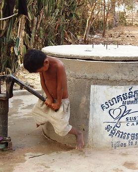 Well- Boy pumping Well #13.JPG
