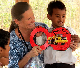 Julie and child explore Dump Truck book