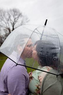kissing under a clear umbrella