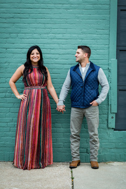 couple in front of teal wall ohio city