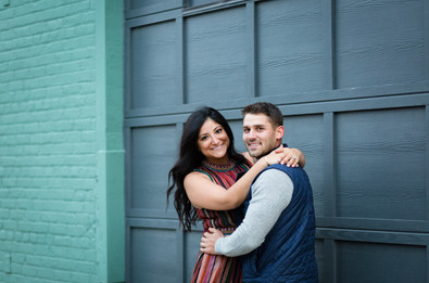 couple in front of teal and blue wall in ohio city