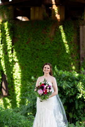bridal portrait in front of ivy wall
