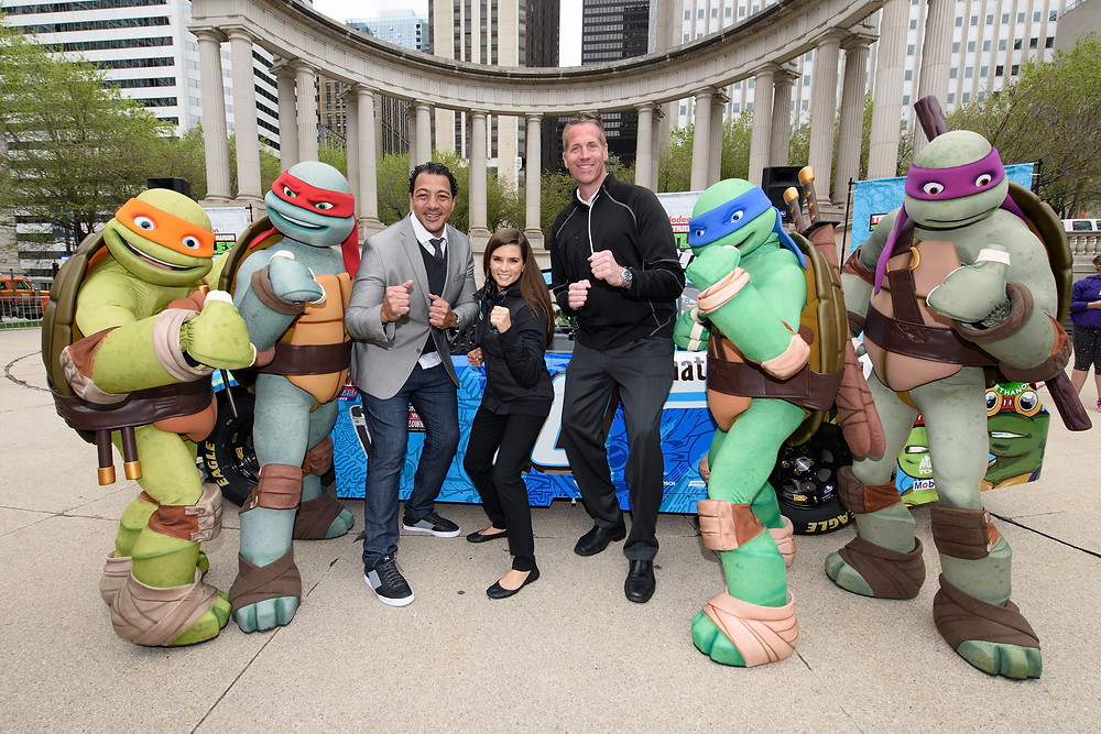 Danica is joined by the tutles and Scott Paddock (right) and Anthony DiCosmo (left)