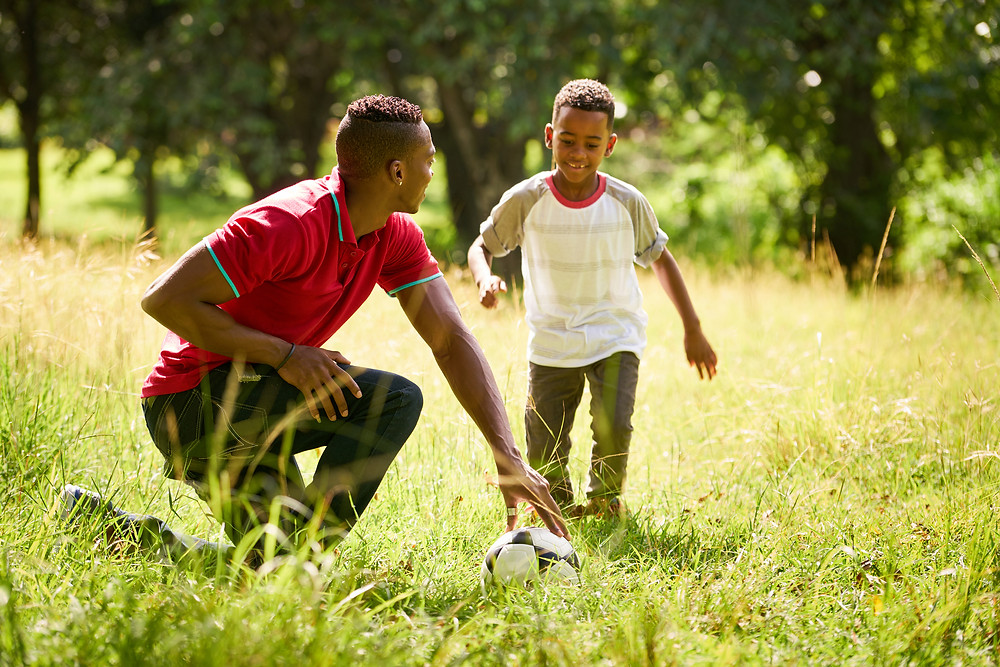 dad and child playing soccer and being mindfull - Strategies for Sanity Blog