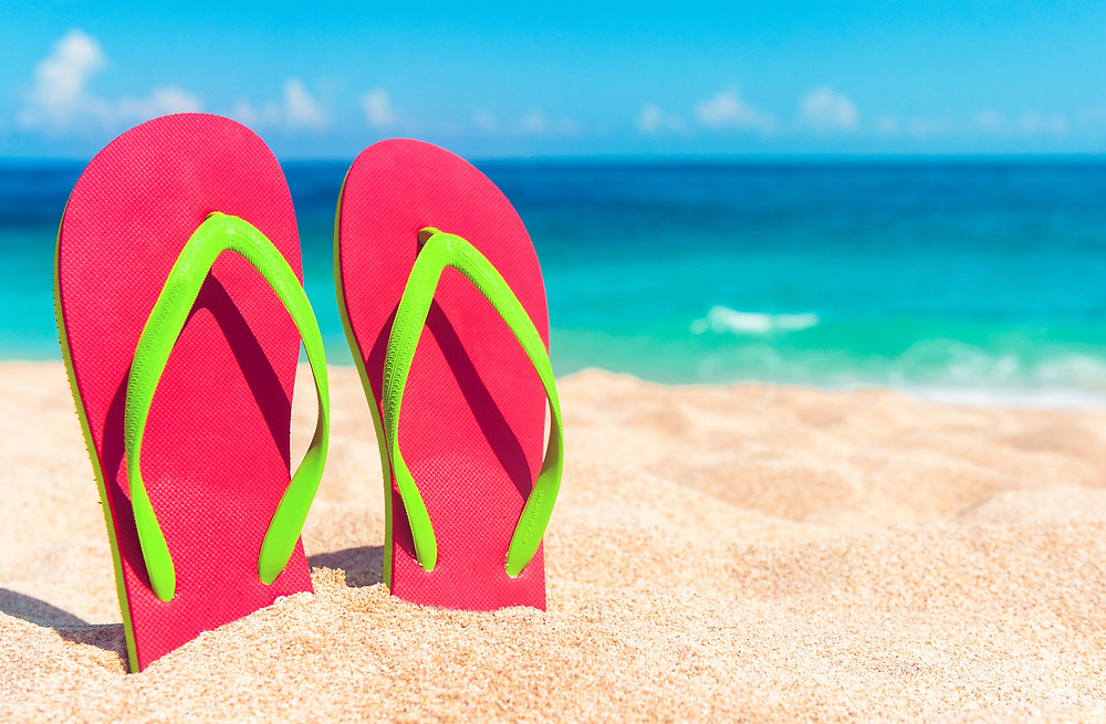 flip flops in the sand on the beach - Strategies for Sanity Blog - Core Counseling Soluions
