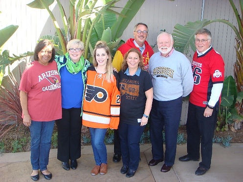 CSAVR Staff pose as. group wearing their favorite team jersey/shirts outside in San Diego sun