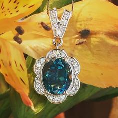 Blue zircon and diamond pendant. #Tresor