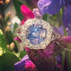 Ceylon sapphire with halo diamonds. Only