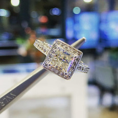 Princess cut diamond offset by pave set