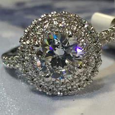 Double halo stunner in 18kt white gold.j