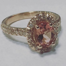 Pink sapphire in rose gold with diamonds
