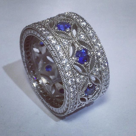 Sapphire and pave set diamond wide band.