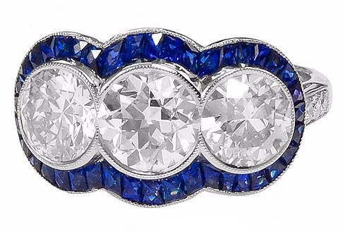 14kt Moissanite Three Round Cut Stones surrounded by Invisibly Set Sapphire