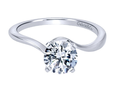 14 kt Solitaire Engagement Ring.