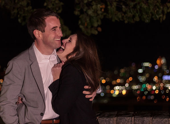 Happy Couple In Front of City Lights