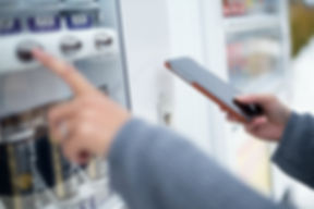 Woman using cellphone to pay the vending