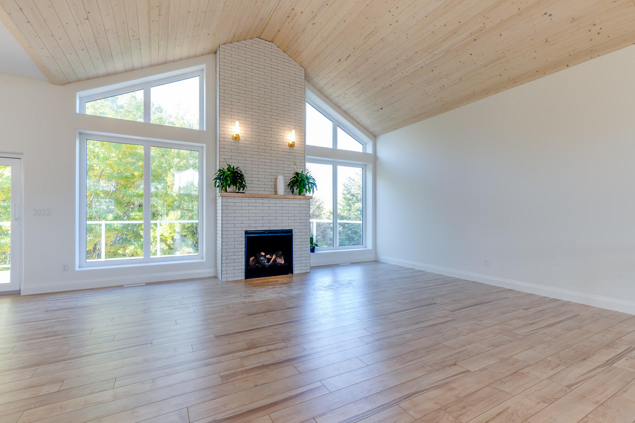Angled Windows Flanking Fireplace