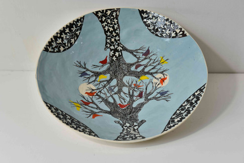 large blue plate - winter tree colourful birds