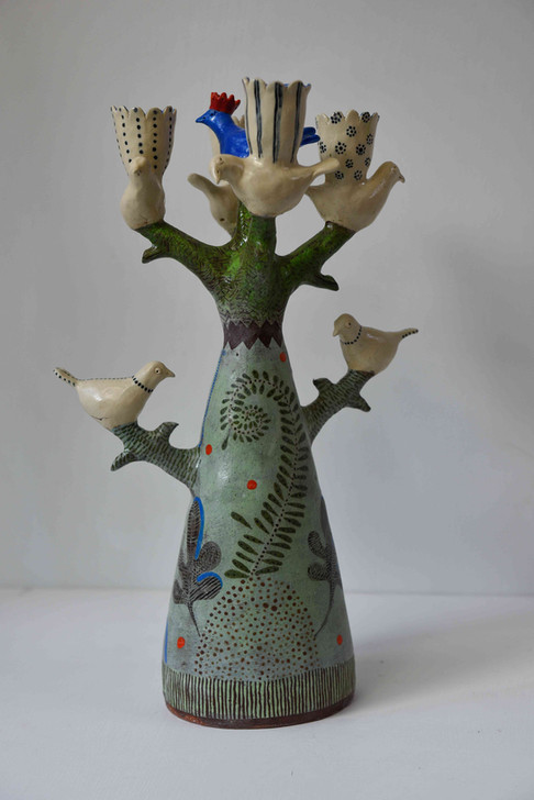 blue bird with red crown tree candelabra