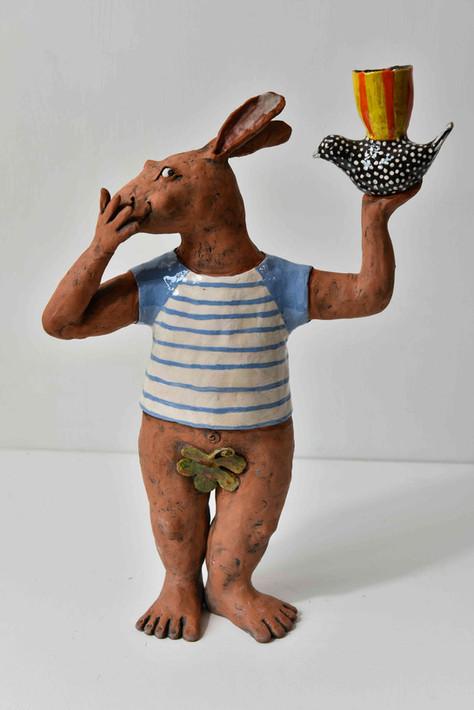terracotta goat with bird candelabra