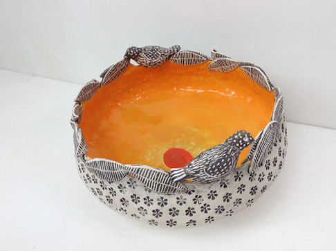 deep orange and black bowl with leaves a