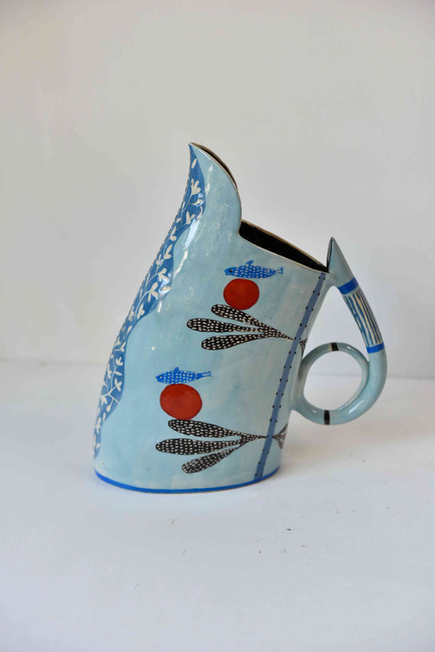 abstract blue jug with red balls and fish